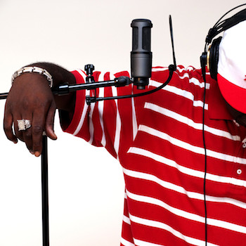 Singer and microphone in recording studio
