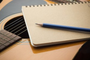 Songwriter's guitar and paper