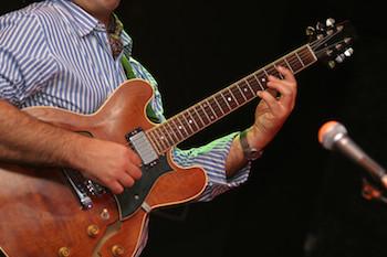 Singer guitarist songwriter